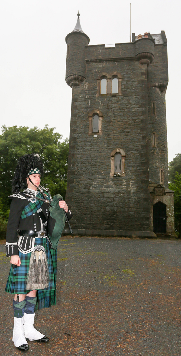 Bagpiper Graham Harris readies himself to mark each half hour before the start of the Battle of the Somme during a ceremony at Helen's Tower in Bangor