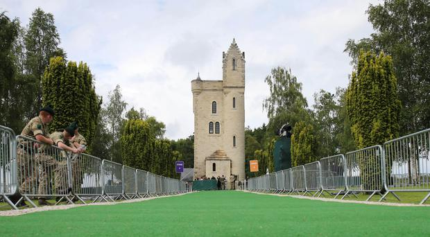 A green carpet is laid at the Ulster Memorial Tower in Thiepval