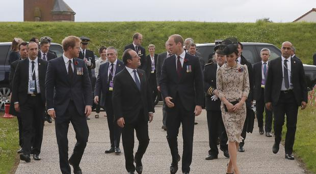 France's President Francois Hollande, greets Prince William, his wife Kate, the Duchess of Cambridge, and Prince Harry as they arrive in Thiepval, northern France
