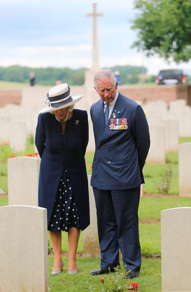 Camilla and Prince Charles pay a poignant first visit to her great-uncle's grave