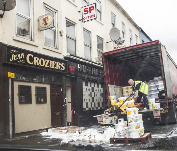 The clean-up gets under way after the accident in Newry