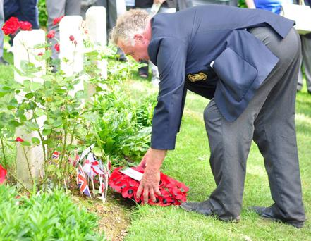 Joseph McBride laying a wreath at his uncle's grave in France