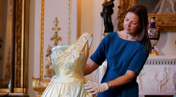 Caroline de Guitaut, senior curator at The Royal Collection, with an evening dress by Sir Norman Hartnell