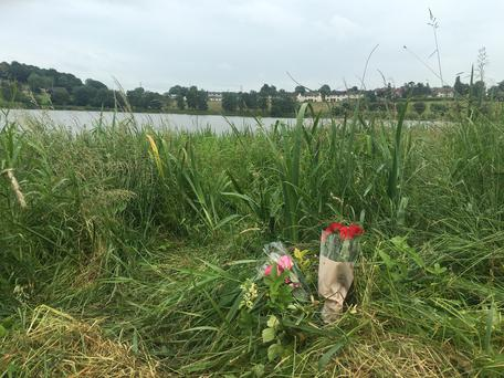 Floral tributes at Black Lough in Dungannon