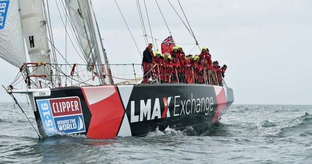 The crew of LMAX Exchange celebrate after crossing the finish line first, beating the Derry-Londonderry-Doire clipper