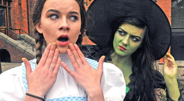 The Wicked Witch of the West sneaks up behind an unsuspecting Dorothy at the launch of the EastSide Arts Festival