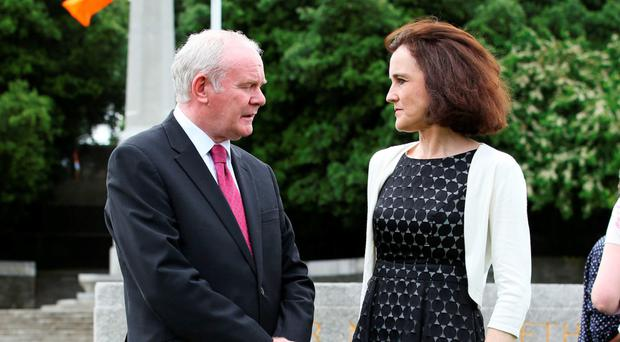 Secretary of State for Northern Ireland Theresa Villiers with Deputy First Minister Martin McGuinness at the ceremony in Dublin. Photo: Brian Lawless/PA Wire