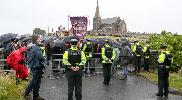 Members of Portadown District LOL No.1 are prevented from completing the annual Drumcree Sunday church parade