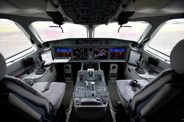 The inside of the cockpit of the Bombardier CS100 passenger jet is pictured on the opening day of the Farnborough Airshow