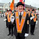 Orangemen lead off the main Belfast parade from Carlisle Circus