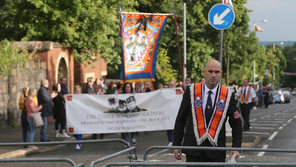 Orange Order members march on Woodvale Road in Belfast as part of the annual Twelfth of July parades across Northern Ireland