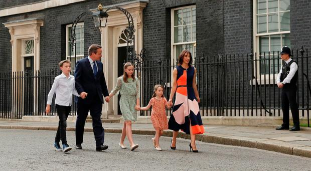 Outgoing PM David Cameron leaves Downing Street with his family, son Elwen, daughters Nancy and Florence and wife Samantha yesterday