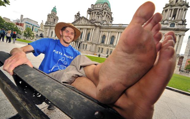 Eamonn Keaveney puts his feet up outside Belfast City Hall yesterday