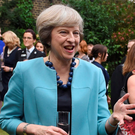 Prime Minister Theresa May at a reception for the Police Bravery Award in the garden of 10 Downing Street yesterday