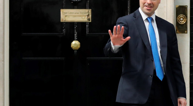 James Brokenshire waves to the media outside 10 Downing Street