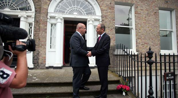 Leader of Fianna Fail Micheal Martin (right) is greeted by French ambassador to Ireland Jean-Pierre Thebault at the French embassy in Merrion Square, Dublin