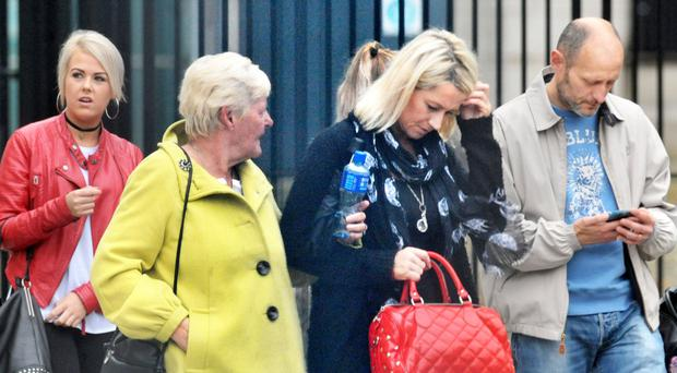 Relatives and friends of Samurai sword victims Stanley Wightman and UDA chief Colin 'Bap' Lindsay leave court yesterday