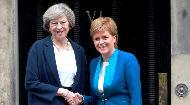 Prime Minister Theresa May is greeted by Scotland First Minister Nicola Sturgeon yesterday