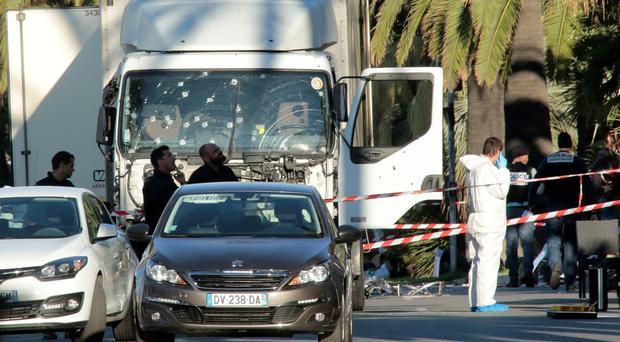 The bullet-riddled truck used by the attacker. (Photo by Patrick Aventurier/Getty Images)