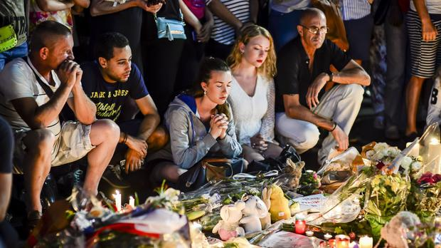 People gather on the Promenade des Anglais to mourn victims of the attack