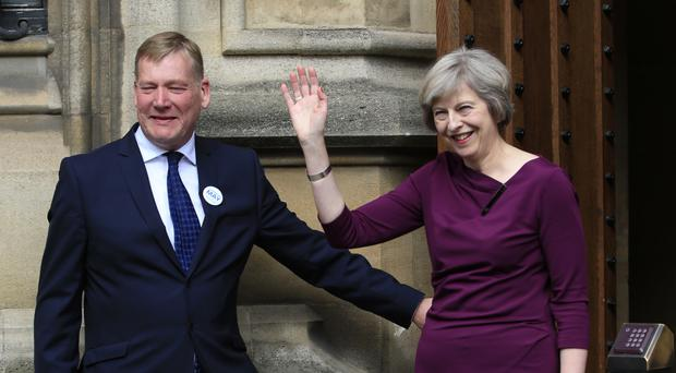 Prime Minister Theresa May with NIO junior minister Kris Hopkins