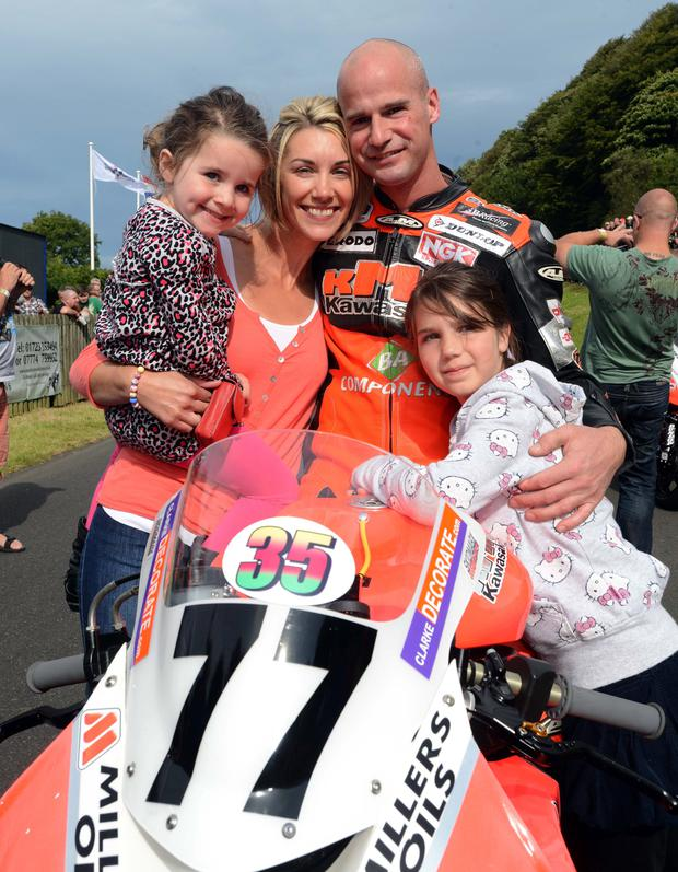 Ryan Farquhar, his wife Karen and children Keeley and Mya before his recent accident