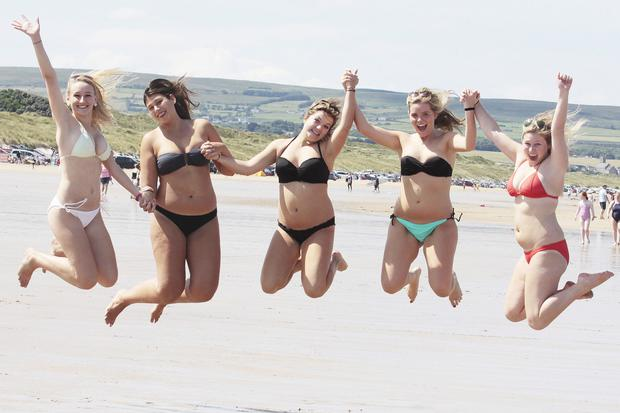 Students from Chicago enjoy the sun on Portstewart Strand