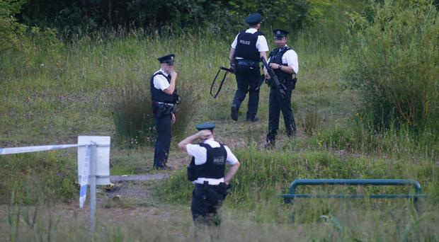 Police at the scene in Colin Glen Forest Park on Tuesday night