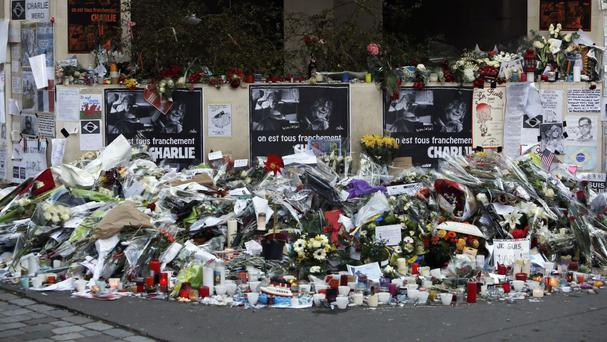 Flowers near the offices of satirical magazine Charlie Hebdo, as the EU experienced a 'massive' number of casualties caused by terrorist attacks in 2015