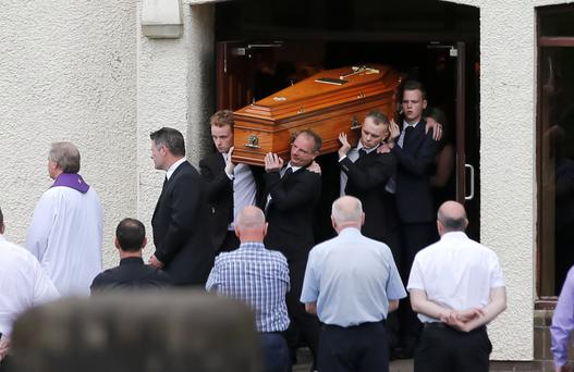 Mourners carry the coffin of Stevie McTeague at his funeral yesterday