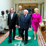 French President Francois Hollande walks with President of Ireland Michael D Higgins and his wife Sabina at Aras an Uachtarain