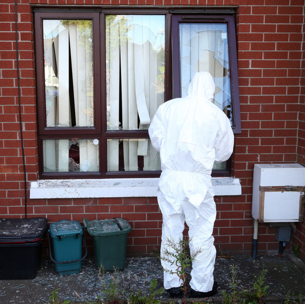 A forensics officer examines the scene of the assault