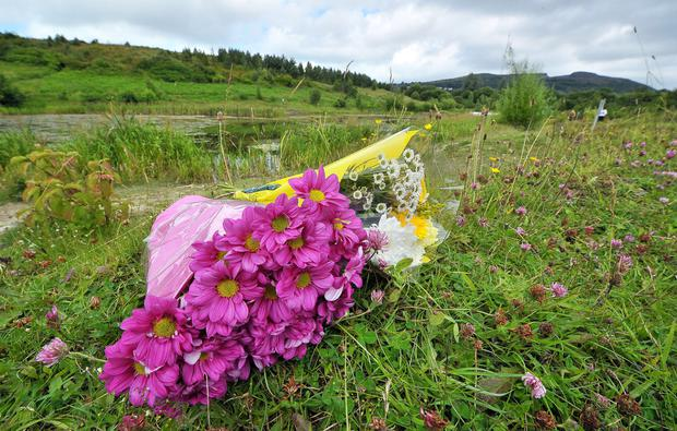 Flowers at the scene in Colin Glen Forest Park where Valerie Armstrong was struck by a scrambler motorbike