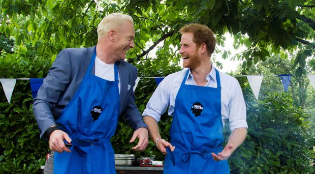 Prince Harry with Iwan Thomas