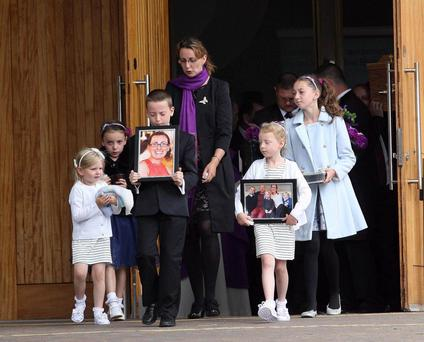 Emotional farewells being said yesterday at the funeral of mother-of-three Valerie Armstrong, who died after being struck by a dirt bike last week. Mrs Armstrong is survived by her husband of 11 years, Seamus, and her three children Dylan (10), Lucy (7) and five-year-old Sophie-Belle. Family, friends and the family's pet dog were at the service in the Church of the Nativity, Poleglass