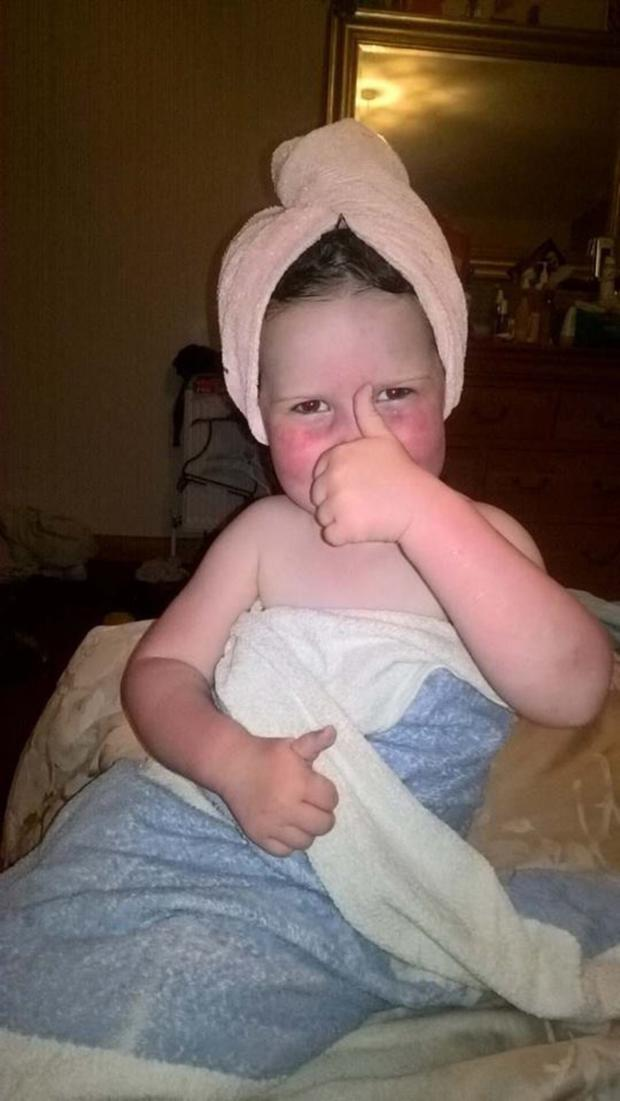 Maisie giving the thumbs-up to show she is better