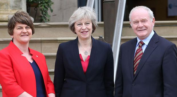 Theresa May, centre, met Arlene Foster and Martin McGuinness at Stormont Castle in Belfast