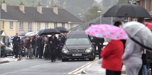 The funeral cortege of Donal Kildea makes its way to the Church of the Immaculate Conception on Barrack Street