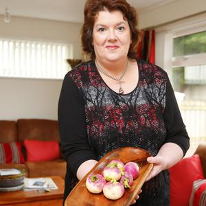 Paula McIntyre, with her £7 turnips in her Portstewart home