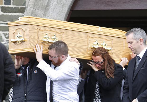 Friends and family carry the coffin of Terry Fitzsimons
