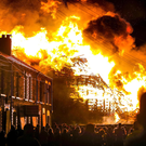 The Chobham Street Bonfire in east Belfast rages in close proximity to a row of houses