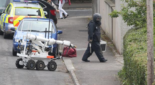 A bomb disposal officer at the scene of the suspect device