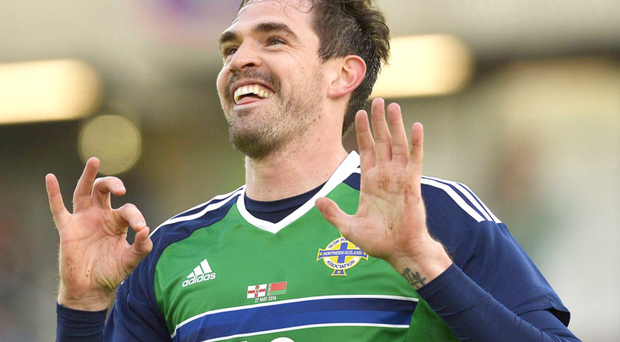 Kyle Lafferty celebrates scoring on his 50th appearance for Northern Ireland