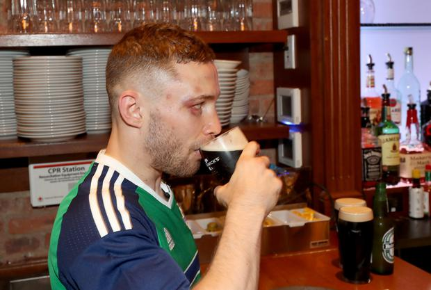 Carl Frampton enjoys a pint after meeting the fans and buying them a round at Annie Moore's bar in Manhattan the day after winning the WBA featherweight belt following his points victory over Mexican Leo Santa Cruz at the Barclays Center, Brooklyn, New York