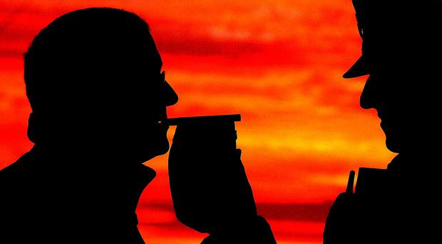 Police have insisted they were right to breathalyse a man found asleep in a car in Co Down