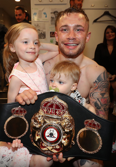 Frampton with his children Carla and Rossa after defeating Leo Santa Cruz in the early hours of Sunday