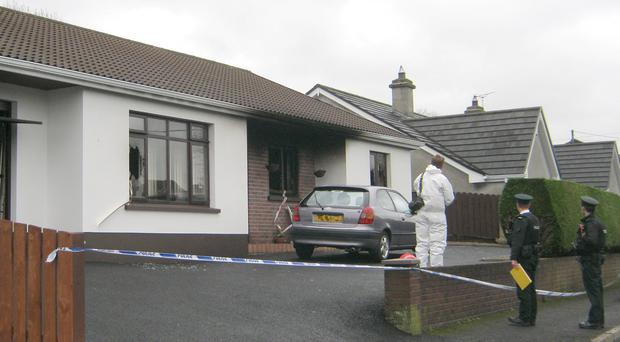 Police and forensics at the scene of the fire in Enniskillen last year