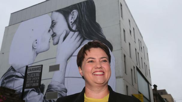 Scottish Conservative leader Ruth Davidson poses in front of a mural called Love Wins in Belfast