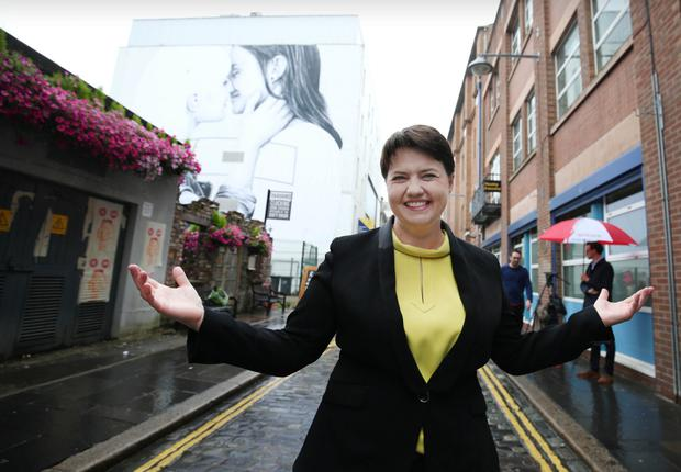 The leader of the Scottish Conservatives Ruth Davidson in front of a Belfast mural depicting a lesbian kiss in support of same-sex marriage