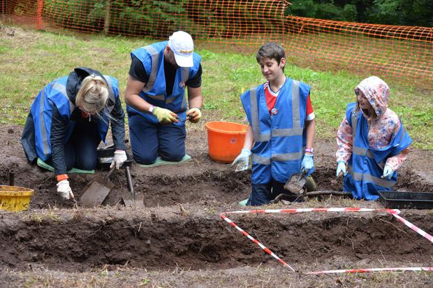 Some of the young volunteers, 300 of whom are taking part in the excavation